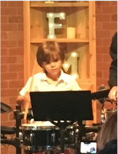 Boy having fun playing the Drums